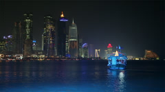 Doha, Qatar, West Bay central financial district across bay, night Stock Footage