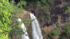 Close up Panning Down to the Bottom of the Rainbow Falls at Kauai, Hawaii - stock footage