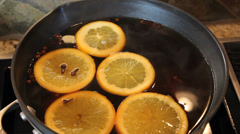 Apple Cider with Cloves Orange Slices and Cinnamon Sticks Cooking 1080p Stock Footage