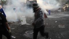 Protesters Run from Tear Gas Stock Footage