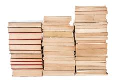 piles of weathered old books - stock photo