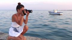 Nice girl taking a photograph with her camera Stock Footage