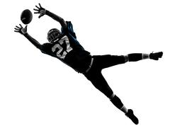 american football player man catching receiving silhouette - stock photo
