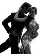 Couple man woman ballroom dancers tangoing  silhouette Stock Photos