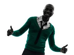 African black man smiling thumb up silhouette Stock Photos