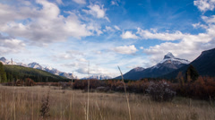Dolly move up of clouds at Rocky Mountain Stock Footage