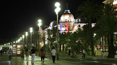 Stock Video Footage of Night Lights Negresco Hotel Nice French Riviera People Walking Car Traffic Lit