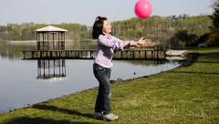 Playing ball near a lake Stock Footage