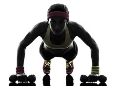 woman exercising fitness workout push ups  silhouette - stock photo