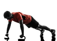 man exercising fitness workout push ups  silhouette - stock photo