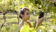 A girl with a bunch of grapes Stock Footage