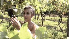 a girl with a bunch of grapes - stock footage
