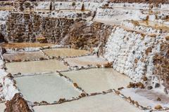 Maras salt mines peruvian andes  cuzco peru Stock Photos