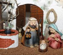 jesus joseph with the beard and the stick and mary in a manger on christmas 1 - stock photo
