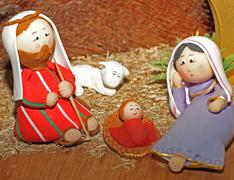 jesus, joseph and mary in a manger - stock photo