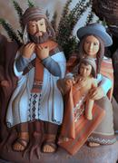 The holy family with clothes bolivians with cloak  1 Stock Photos