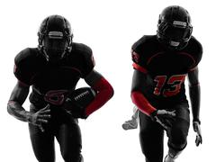 Two american football players running silhouette Stock Photos