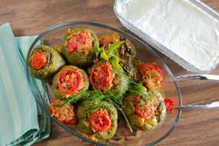 turkish stuffed green pepper dolma's with yogurt - stock photo
