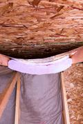 insulation stages of attic - stock photo