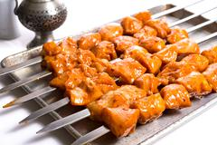 Seasoned chicken skewers ready to grill Stock Photos