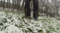 Feet of  man go on  grass and snow in  winter HD Footage