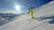 Stock Video Footage of side view alpine skier skiing in short swings
