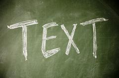 Text written with chalk on blackboard Stock Photos