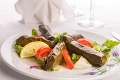 Turkish style dolmas arranged with tomatoes lemon and lettuce Stock Photos