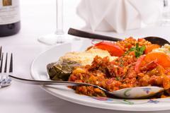 Appetizer sampler plate with turkish ezme, hummus, babaganoush and dolma Stock Photos