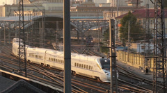 The train is moving slowly out of the Beijing station,China Stock Footage