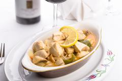 Lemon chicken complimented with red wine Stock Photos