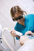 Patient undergoing skin treatment with a laser Stock Photos