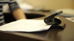 Hole punch for binding documents Stock Footage