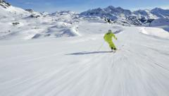 Alpine skier enjoying skiing Stock Footage
