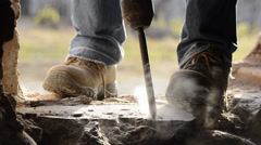 Worker using jackhammer Stock Footage