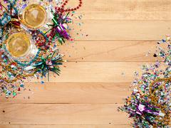 Stock Photo of new year's: confetti with champagne to celebrate