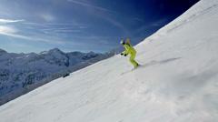 Alpine skier skiing in short swings on ski piste Stock Footage