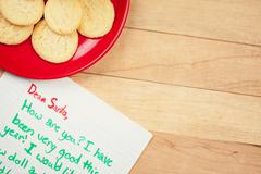 Stock Photo of christmas: cookies for santa and wish list