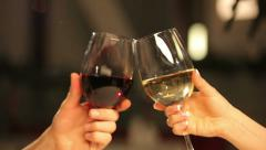 Close up of two women's hands toasting with wine glasses Stock Footage