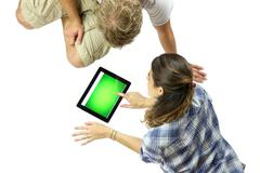 using a digital tablet - stock photo
