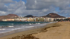 Spain - Gran Canaria - Las Palmas seen from the city beach - stock footage
