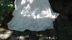 Bridal Gown White Wedding Dress Train Floats Along Light Shadows Outdoors Motion Stock Footage