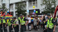 Police intercept gay lesbian parade members and city people Stock Footage