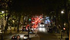 London, night traffic jam drives down towards tower of london and tower bridge Stock Footage