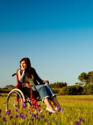 handicapped woman on wheelchair - stock photo