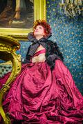 Baroness in baroque salon Stock Photos