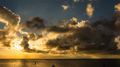 Beautiful Sunset Timelapse, silhouetted people, Flic-En-Flac, Mauritius Stock Footage