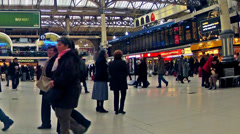 London time table view timelapse of commuters inside victoria railway station Stock Footage
