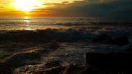 Stock Video Footage of Sunset and the increasing wave of the sea