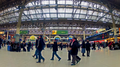 London, side view timelapse of commuters inside victoria railway station Stock Footage